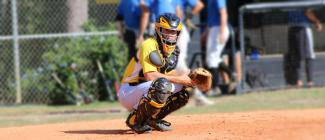 PHSC baseball catcher behind the plate looking at the camera
